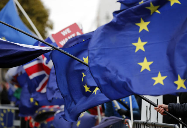 The EU and British flags wave at the demonstrations area near the parliament building in London, Wednesday, Jan. 16, 2019. British lawmakers overwhelmingly rejected Prime Minister Theresa May's divorce deal with the European Union on Tuesday, plunging the Brexit process into chaos and triggering a no-confidence vote that could topple her government. (AP Photo/Frank Augstein)