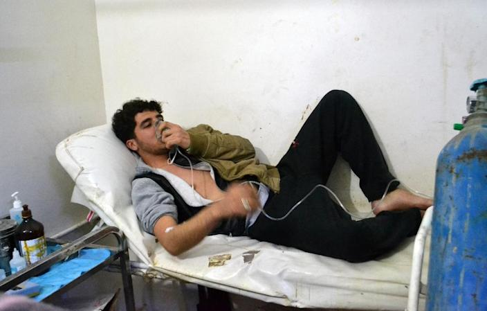 A young man breathes with an oxygen mask on March 17, 2015 at a clinic in the village of Sarmin, southeast of Idlib following reports of an alleged regime gas attack in the area (AFP Photo/Mohamad Zeen)