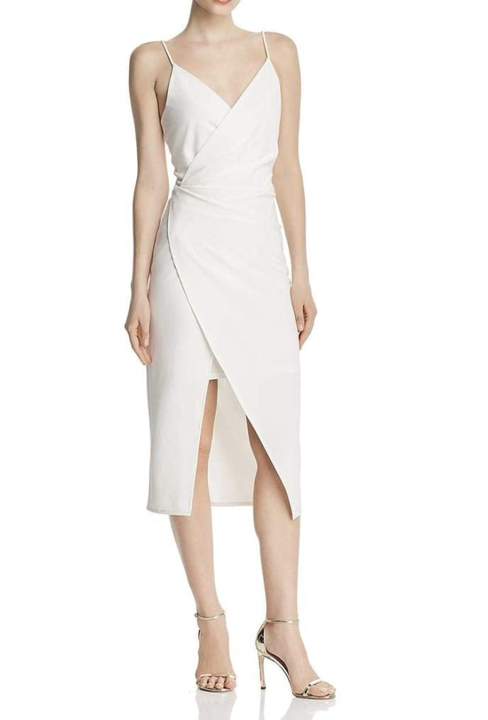 <p>This <span>Betsey Johnson Scuba Crepe V Neck Dress</span> ($29-$90) will look fresh with matching white sandals.</p>