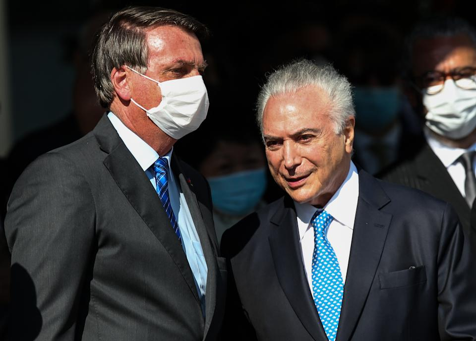 SAO PAULO, BRAZIL - AUGUST 12: President of Brazil Jair Bolsonaro and Brazil's former President Michel Temer, designated to represent Brazil in the mission to help Lebanon, talk during a visit to BASP (Sao Paulo Air Base) to accompany the Brazilian delegation's departure to Lebanon on August 12, 2020 in Sao Paulo, Brazil. Last week, an explosion in the port area of Beirut, the capital of Lebanon, left at least 160 dead and thousands injured. The delegation's mission is to deliver food, medicine and hospital supplies, including 100,000 surgical masks and mechanical respirators. (Photo by Alexandre Schneider/Getty Images)