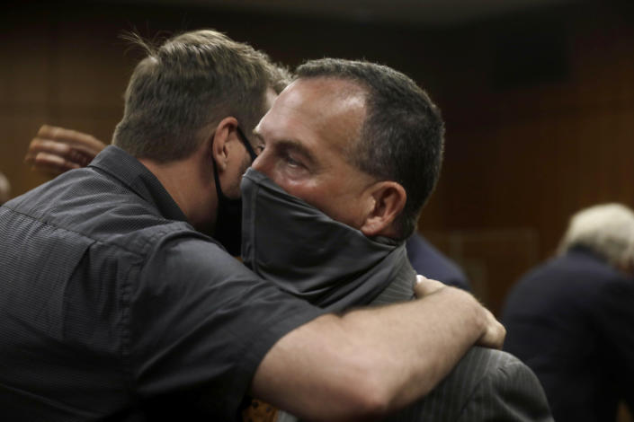 Deputy District Attorney John Lewin, right, is congratulated after Robert Durst convicted Friday, Sept. 17, 2021, in Inglewood, Calif., of murdering Susan Berman 20 years ago. Durst was not in court to hear the verdict read because he was in isolation following an exposure to COVID-19. (Genaro Molina/Los Angeles Times via AP, Pool)