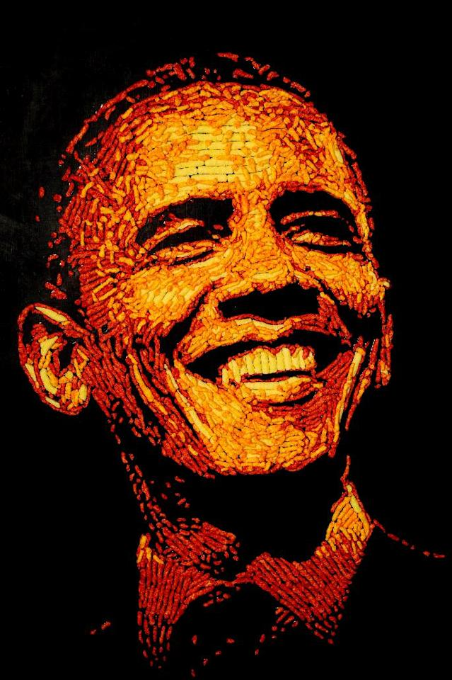 IMAGE DISTRIBUTED FOR CHEETOS - President Barack Obama is immortalized in a 3 feet by 4 feet portrait made entirely of more than 2,000 Cheetos cheese snacks by Colorado Springs. Colo. artist, Jason Baalman Tuesday, Oct. 2, 2012. Today, the Cheetos brand unveiled a new electoral polling model with the unveiling of 3 feet by 4 feet one-of-a-kind Cheetos portraits of the Democratic and Republican presidential nominees – President Barack Obama and former Gov. Mitt Romney. Debuting on Facebook today at 11 a.m. CT, fans are encouraged to vote for their candidate's portrait – made entirely of more than 2,000 individual Cheetos cheese snacks – for a chance to win the actual portrait. (Photo by Jack Dempsey/Invision for Cheetos/AP Images)