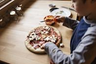<p>Have friends roll out the dough and finish off each pizza with an assortment of toppings before popping their creations in the oven. </p>