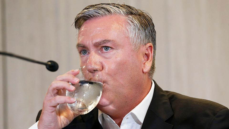 Collingwood president Eddie McGuire is seen here taking a drink during a press conference.