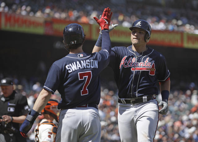 Atlanta Braves' Austin Riley, right, celebrates with Dansby Swanson (7) after hitting a two-run home run off San Francisco Giants' Tony Watson in the eighth inning of a baseball game Thursday, May 23, 2019, in San Francisco. (AP Photo/Ben Margot)