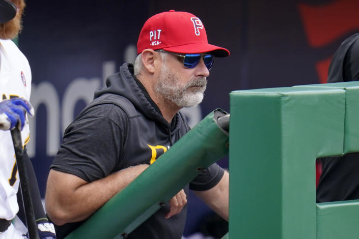 Pittsburgh Pirates manager Derek Shelton stands in the dugout during a baseball game against the Milwaukee Brewers in Pittsburgh, Sunday, July 4, 2021. (AP Photo/Gene J. Puskar)