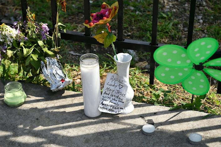 A memorial stands at 75th Street and Stewart Avenue in Chicago on Tuesday, July 30, 2019, where two women were slain in a drive-by shooting.
