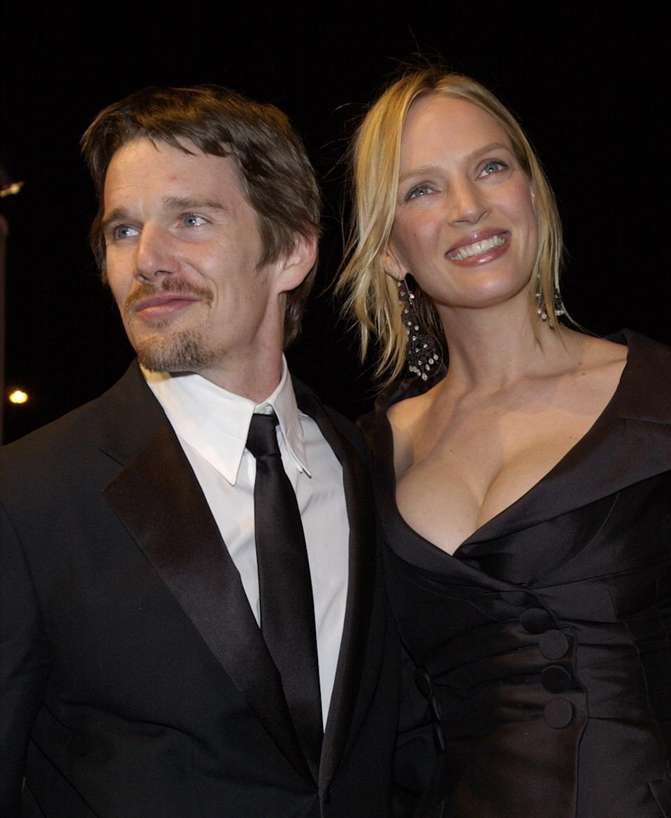 Actor Ethan Hawke and actress Uma Thurman arrive at the Vanity Fair Oscar Party, Sunday, March 24, 2002, in West Hollywood, Calif.  (AP Photo/Chris Weeks)