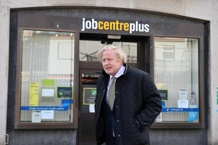 UK prime minister Boris Johnson walks past a Job Centre Plus in Truro, Cornwall, England during his visit to the region on 7 April. Photo: Justin Tallis/WPA Pool/Getty Images