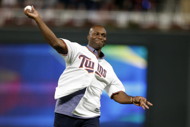 Former Minnesota Twins player Torii Hunter throws out a ceremonial first pitch before Game 3 of a baseball American League Division Series between the Twins and the New York Yankees, Monday, Oct. 7, 2019, in Minneapolis. (AP Photo/Bruce Kluckhohn)