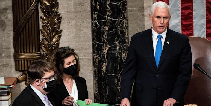 Mike Pence in the US Senate next to two aides.
