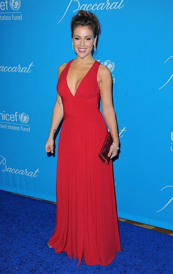 "Alyssa Milano looked stunning in a cleavage-baring floor-length red gown. Jason Merritt/<a href=""http://www.gettyimages.com/"" target=""new"">GettyImages.com</a> - December 10, 2009"