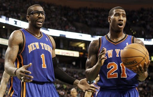 New York Knicks' Amare Stoudemire (1) and Iman Shumpert look to an official after a foul was called on the Knicks during the second quarter of an NBA basketball game in Boston Friday, Feb. 3, 2012. (AP Photo/Winslow Townson)