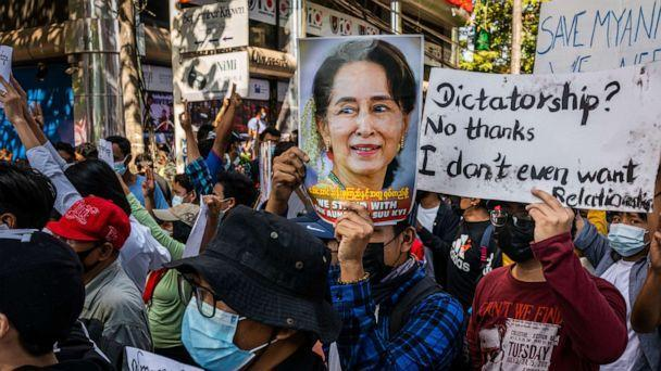PHOTO: Protesters hold images of de-facto leader Aung San Suu Kyi, Feb. 10, 2021, in Yangon, Myanmar. (Getty Images)