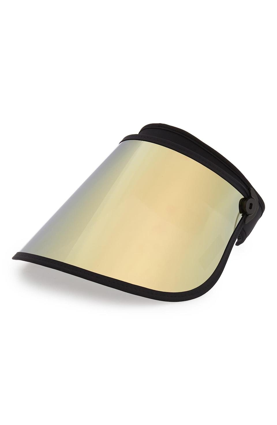 <p>If you love all things gold, you need this champange mirror-tinted <span>Bluestone Sun Shield Full Lux Visor</span> ($72). It also comes in black or a green-blue mermaid variation.</p>