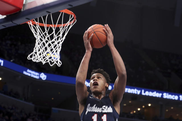 Jackson States' forward Jayveous McKinnis (11) goes up for a basket in the first half of an NCAA college basketball game against Memphis, Saturday, Dec. 21, 2019, in Memphis, Tenn. (AP Photo/Karen Pulfer Focht)