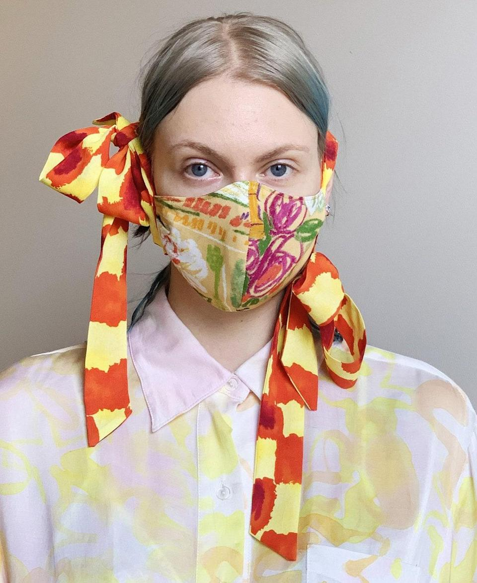 "Halloween is the perfect reason to make use of this weird and whimsical masterpiece from Collina Strada, even just for a wild Instagram post. $100, Collina Estrada. <a href=""https://collinastrada.com/collections/accessories/products/fashion-face-mask-with-bows"" rel=""nofollow noopener"" target=""_blank"" data-ylk=""slk:Get it now!"" class=""link rapid-noclick-resp"">Get it now!</a>"