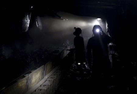 Miners work about 500 meters underground at the Boleslaw Smialy coal mine, a unit of coal miner Kompania Weglowa (KW) in Laziska Gorne, Silesia, southern Poland, September 11, 2015. REUTERS/Kacper Pempel/Files