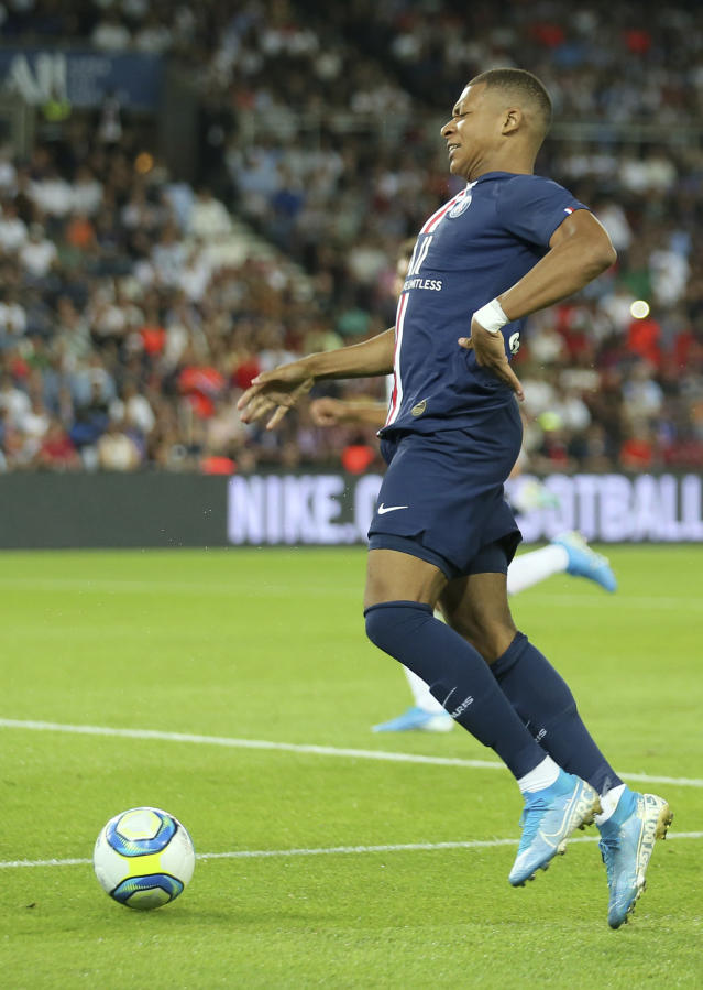 PSG's Kylian Mbappe suffers an injury during the French League One soccer match between Paris Saint Germain and Toulouse at the Parc des Princes Stadium in Paris, France, on Sunday, Aug. 25, 2019. (AP Photo/David Vincent)