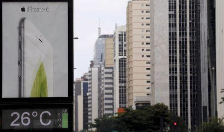 An advertisement board displays an iPhone 6 at Paulista avenue in Sao Paulo December 16, 2014. REUTERS/Paulo Whitaker
