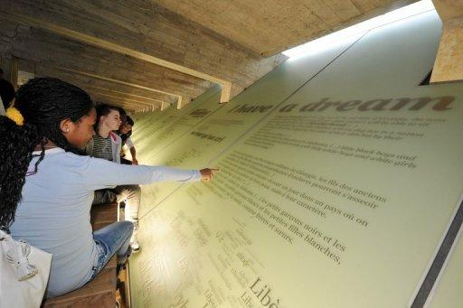 File picture shows visitors to the Abolition of Slavery Memorial Museum in Nantes, which was France's largest slave port. Up to 27 million people are living in slavery around the world, US Secretary of State Hillary Clinton estimated as the US unveiled Tuesday its annual report into human trafficking
