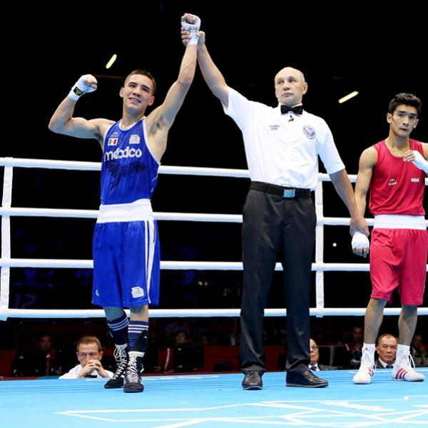 LONDON, ENGLAND - JULY 28: Oscar Valdez Fierro of Mexico celebrates his victory over Shiva Thapa of India during their Men's Bantam Weight (56kg) bout on Day 1 of the London 2012 Olympic Games at ExCeL on July 28, 2012 in London, England. (Photo by Scott Heavey/Getty Images)