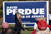 Sen. Kelly Loeffler, R-Ga., takes the stage before Vice President Mike Pence during a Defend the Majority Rally, Friday, Nov. 20, 2020 in Canton, Ga. (AP Photo/Ben Gray)