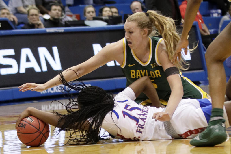 Baylor forward Lauren Cox, top, and Kansas guard Zakiyah Franklin (15) dive for the ball during the second half of an NCAA college basketball game in Lawrence, Kan., Wednesday, Jan. 15, 2020. (AP Photo/Orlin Wagner)