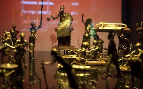 Benin has demanded restitution of national treasures taken from the former French colony Dahomey and now on display in a French museum - Credit: GERARD JULIEN /AFP