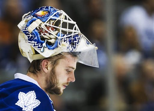 Toronto Maple Leafs goalie Jonas Gustavsson looks down after replacing James Reimer while playing against the Montreal Canadiens during the third period of an NHL hockey game, Saturday, Feb. 11, 2012, in Toronto. The Canadiens won 5-0. (AP Photo/The Canadian Press, Nathan Denette)