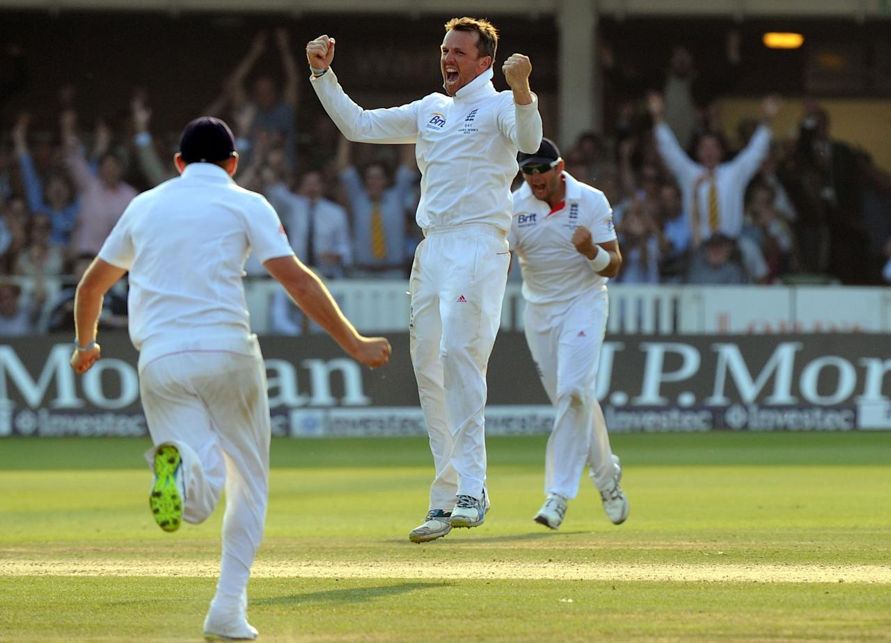 England's Graeme Swann celebrates taking the final Australian wicket to win the match on day four of the Second Investec Ashes Test at Lord's Cricket Ground, London.