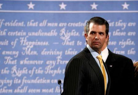 FILE PHOTO - Donald Trump Jr. stands onstage with his father Republican U.S. presidential nominee Donald Trump after Trump's debate against Democratic nominee Hillary Clinton at Hofstra University in Hempstead, New York, U.S. on September 26, 2016.  REUTERS/Brian Snyder/File Photo