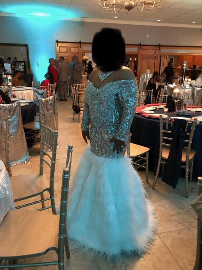 Bride is feathered and jewelled wedding dress