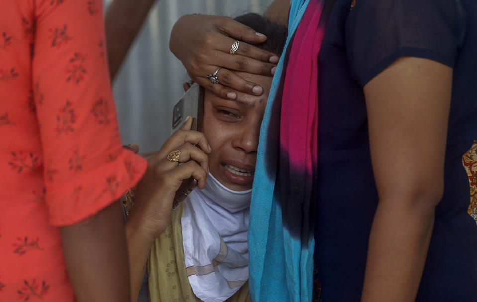 Relatives of a person who died of COVID-19 mourn outside a field hospital in Mumbai, India, Monday, May. 3, 2021..(AP Photo/Rafiq Maqbool)