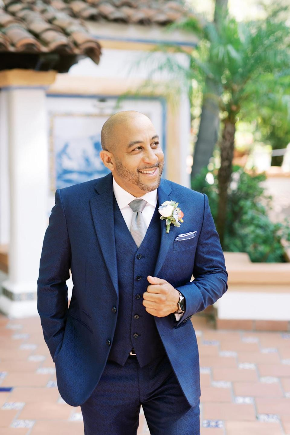 """<p>Charles donned a custom navy suit, made by California-based tailor <a href=""""http://www.peterdaniel.net/"""" rel=""""nofollow noopener"""" target=""""_blank"""" data-ylk=""""slk:Peter Daniels"""" class=""""link rapid-noclick-resp"""">Peter Daniels</a>, on the big day; a vest, hand-made shirt (complete with his initials), and silver tie completed the ensemble. """"Charles also rocked his birthday gift—a <a href=""""https://www.movado.com/us/en/home"""" rel=""""nofollow noopener"""" target=""""_blank"""" data-ylk=""""slk:Movado"""" class=""""link rapid-noclick-resp"""">Movado</a> Bold Chronograph watch,"""" says his bride. """"It was the perfect companion to his metal gray wedding band.""""</p>"""