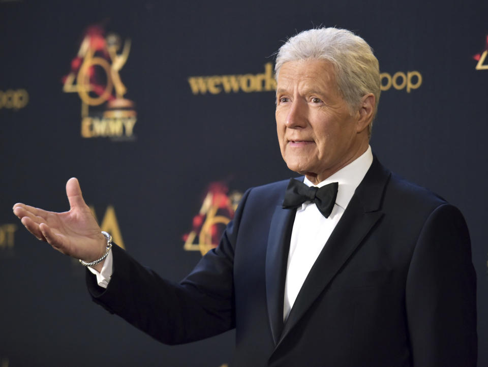"""FILE - Alex Trebek poses in the press room at the 46th annual Daytime Emmy Awards on May 5, 2019 in Pasadena, Calif. More than two months after Trebek's death, fans of """"Jeopardy!"""" finally got the chance to say goodbye. A video tribute to the host opened the Friday, Jan. 8, 2021 episode of the quiz show, the final one that Trebek taped before pancreatic cancer claimed his life on Nov. 8. (Photo by Richard Shotwell/Invision/AP, File)"""