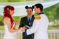 """photo by:Shari Photography<br> The pastor wore Mickey Mouse ears and the couple had their first kiss as husband and wife to The Little's Mermaid's """"Kiss the Girl."""""""