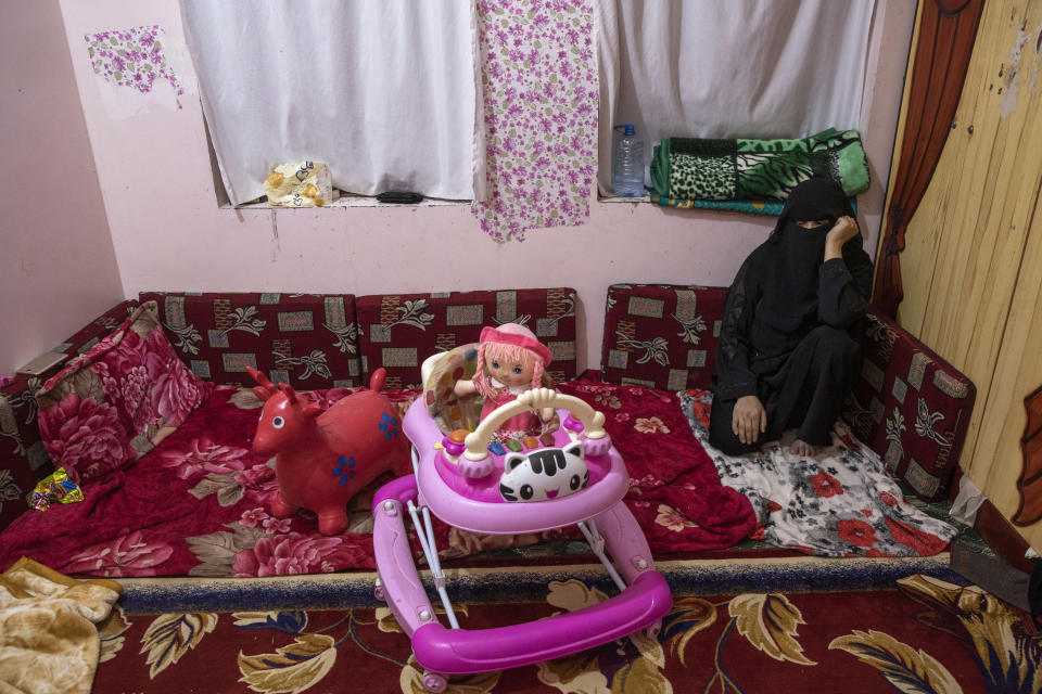 Gamila Salih Ali, mother and wife of two-year-old Liyan Taher, and 32-year-old Taher Farag, who were both killed in a ballistic missile and an explosive-laden drone fired by Yemen's Houthi rebels that hit a fuel station on June 5, 2021 in Rawdha neighborhood, sits near her daughters toys at their home in Marib, Yemen, Saturday, June 19, 2021. (AP Photo/Nariman El-Mofty)