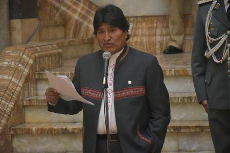 Bolivia's President Evo Morales reads a document during a news conference at the presidential palace in La Paz, Bolivia, May 9, 2016. Enzo de Luca/Courtesy of Bolivian Presidency/Handout via REUTERS