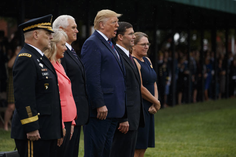 "President Donald Trump sings ""God Bless America"" during an Armed Forces welcome ceremony for the new chairman of the Joint Chiefs of Staff Gen. Mark Milley, Monday, Sept. 30, 2019, at Joint Base Myer-Henderson Hall, Va. From left, Milley, Hollyanne Milley, Vice President Mike Pence, Defense Secretary Mark Esper, and Leah Esper. (AP Photo/Evan Vucci)"