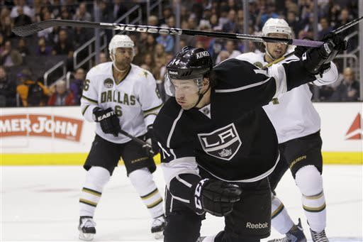 Los Angeles Kings' Justin Williams goes after the puck during the second period of an NHL hockey game against the Dallas Stars in Los Angeles, Sunday, April 21, 2013. (AP Photo/Jae C. Hong)