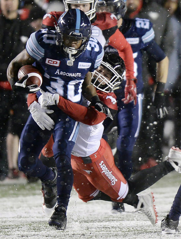 Toronto Argonauts running back Martese Jackson (30) is tackled by Calgary Stampeders defensive back Adam Thibault (2) during second-half CFL football game action in the Grey Cup, Sunday, Nov. 26, 2017, in Ottawa, Ontario. (Justin Tang/The Canadian Press via AP)