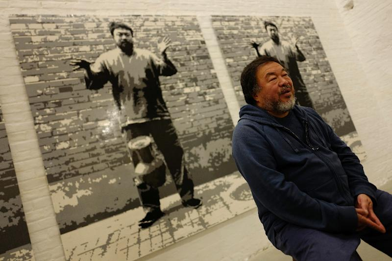 "Chinese artist Ai Weiwei speaks to AFP in front of his work ""Dropping a Han Dynasty Urn, 2016"" in his studio in Berlin (AFP Photo/John MACDOUGALL)"