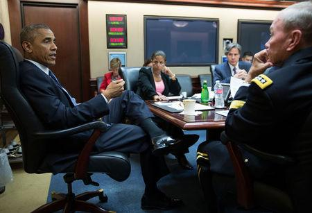 President Barack Obama meets with the National Security Council in the Situation Room of the White House in Washington, in this handout photograph taken and released on August 7, 2014. REUTERS/Pete Souza/White House/Handout