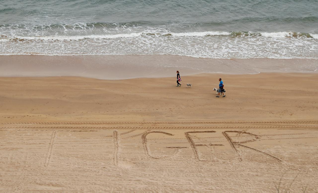 Golf - The 148th Open Championship - Royal Portrush Golf Club, Portrush, Northern Ireland - July 18, 2019  A general view of 'Tiger' written in the sand on the beach by the course in reference to Tiger Woods of the U.S. during the first round  REUTERS/Jason Cairnduff     TPX IMAGES OF THE DAY