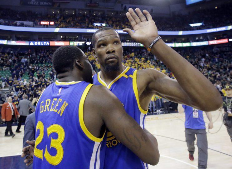 Golden State Warriors forward Kevin Durant waves goodbye to the Utah Jazz. (AP)