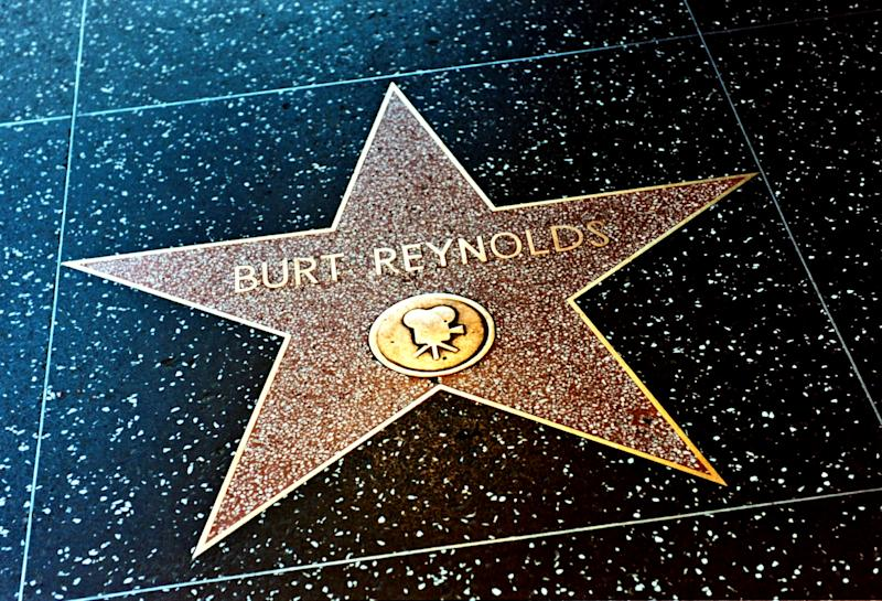 Burt Reynolds was honoured at a ceremony in Los Angeles where flowers were placed on his star on the Walk of Fame (William Conran/PA)