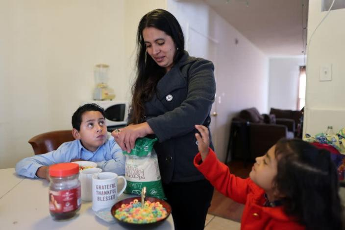 Emiliana, 32, prepares breakfast for her son, Leonardo, 10, and daughter, Emily, 5, at their apartment in Los Angeles