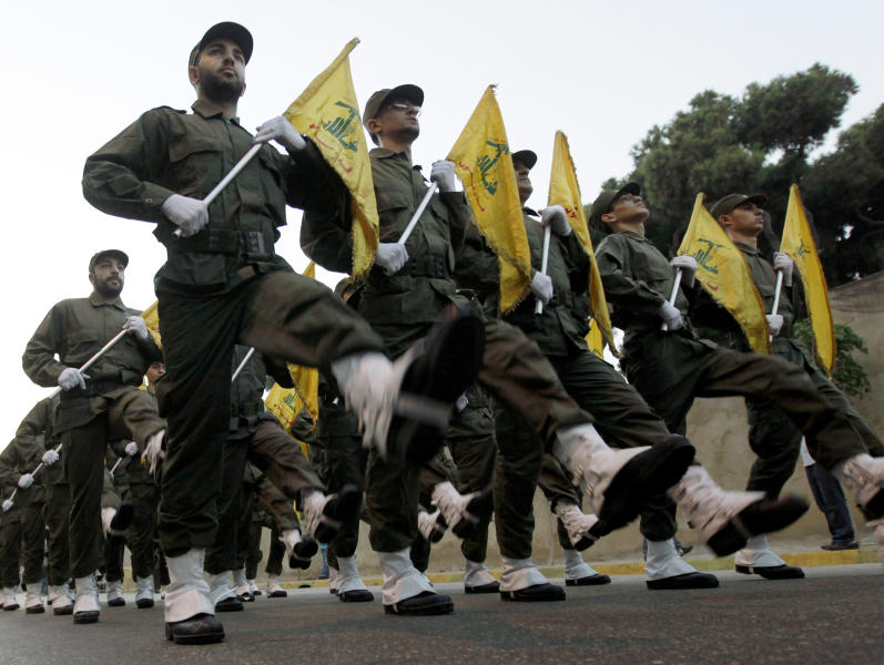 FILE - In this Nov. 12, 2010 file photo, Hezbollah fighters parade during the inauguration of a new cemetery for their fighters who died in fighting against Israel, in a southern suburb of Beirut, Lebanon. From Lebanon and Syria to Iraq, Yemen, and the Gaza Strip, Iran has significantly expanded its footprint over the past decade, finding and developing powerful allies in conflict-ravaged countries across the Middle East. Iran has used groups like the Lebanese Hezbollah to strike its regional foes, and could mobilize them if the latest tensions with the United States lead to an armed conflict, dramatically expanding the battlefield. (AP Photo/Hussein Malla, File)