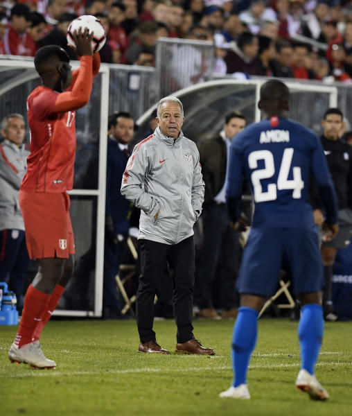 United States head coach Dave Sarachan, center, watches play during the first half of an international friendly soccer match against Peru in East Hartford, Conn., Tuesday, Oct. 16, 2018. (AP Photo/Jessica Hill)